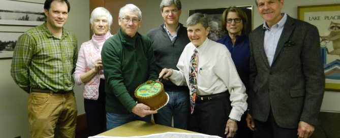 Members of the Board of Trustees of the Lake Placid Land Conservancy (LPLC), the Barkeater Trails Alliance, and LPLC staff gather to celebrate the closing of Wilmington's community forest preserve. Featured (Left to right): Matt McNamara, Georgia Jones, John Rosenthal, Jeffrey Graff, Scott Avery, Liz Clarke, and Gregory Fetters.